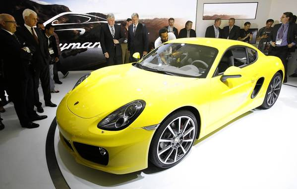 Car lovers are in heaven at the Los Angeles Auto Show, where models such as the Porsche Cayman S are on display.