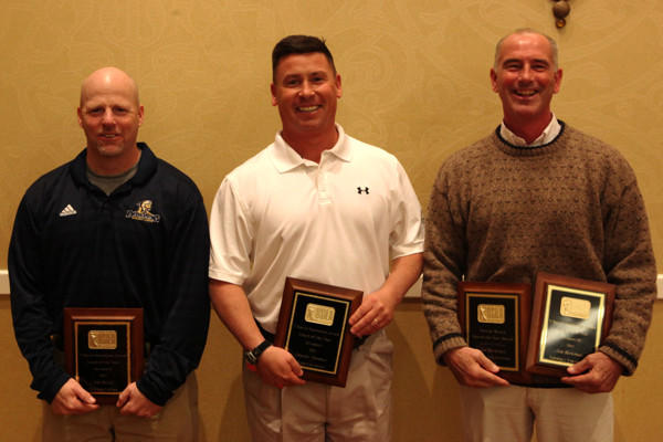 From left, coaches Tim Boyle (Division II Dowling), Charley Toomey (Division I Loyola) and Jim Berkman (Division III Salisbury) with their awards.