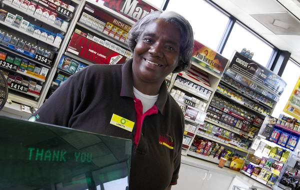 Loretta Walker has been working at the BP Miller Mart as a cashier for the past 19 years. She knows most of her returning customers by name. She greets each with a smile and a personal greeting when they enter the store on Victory Blvd.