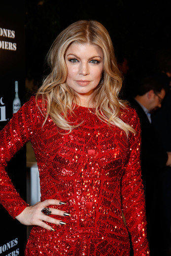 Host Fergie attends the Voli Light Vodka holiday party benefiting Cellphones for Soldiers at SkyBar at the Mondrian Los Angeles on December 6, 2012 in West Hollywood, California.