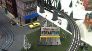 When I heard that Highlandtown had rolled out another holiday train garden, I hailed a cab and told the driver to take me to the Conkling Street firehouse. What I found was the authentic thing.