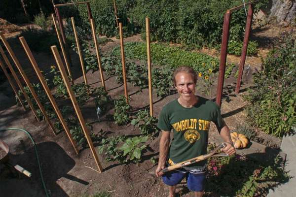 Steven Wynbrandt in his garden, which just three years ago was a barren yard with problematic soil.