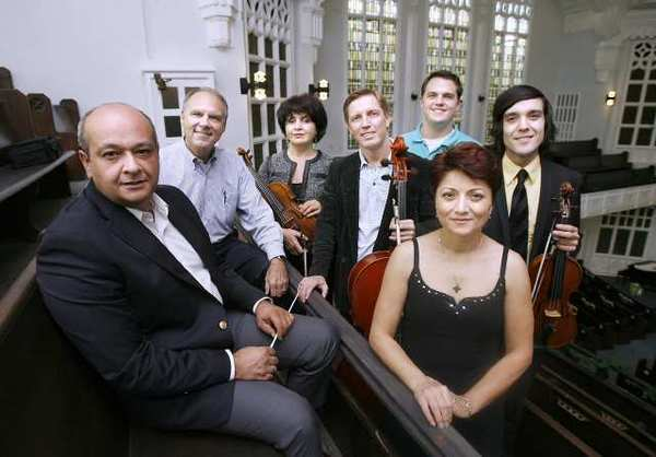 From left, some members of the Glendale Philharmonic include Meastro conductor Mikael Avetisyan, First Baptist Church of Glendale senior pastor Charles Updike, violinist Shushan Akopyan, GP founder and cellist Ruslan Biryukov, church Rev. Matt Andrews, soprano soloist Marina Abrahamyan-Abdasho and violinist and orchestra director Edgar Sandoval at the church in Glendale. The Glendale Philharmonic will perform a holiday concert on Sunday at the church.