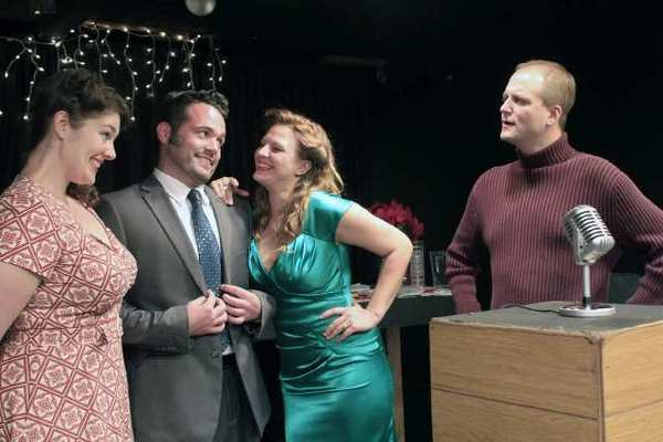 "Playboy Clifton Logan (Clayton J. Meeks) flirts with the KAWL Radio Girls (Julia Plostnieks and Jenn Scuderi) as station owner Michael Anderson (Jim Martyka) looks on disapprovingly in the Theatre Unleashed production of ""It's a Wonderful Life."""