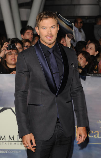 Kellan Lutz leads the pack in a Robert Cavalli tux with navy lapels.