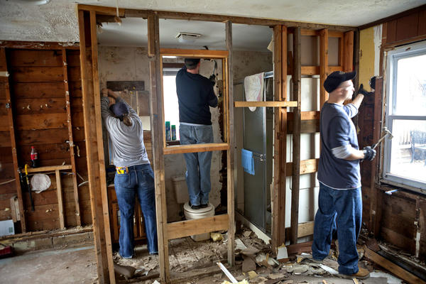 Volunteers with the Jersey Shore Calvary Chapel help gut the Lavallette home of Diana Lamantia, 56, nearly six weeks after Superstorm Sandy. Lamantia lived in the home with her 80-year-old mother, and the two stayed in the home during the storm, watching the water rise to the first step of their staircase.