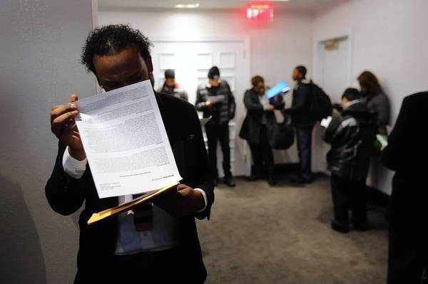 Applicants wait in line to meet potential employers at a job fair this week in New York.