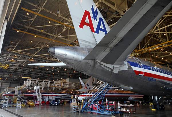 Pilots at American Airlines on Friday ratified a new union labor contract that includes pay raises.