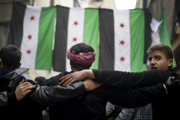 Rebel fighters take part in a demonstration against the Syrian regime in Aleppo on Friday.