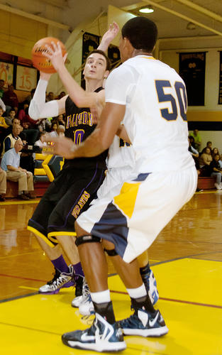 Palasades' Tom Corsello (10) drives for the basket defended by Notre Dame's Vincent Eze (50) during the Jeff Dailey Memorial Foundation Basketball Tip-Off Tournament at Notre Dame High School on Friday night.
