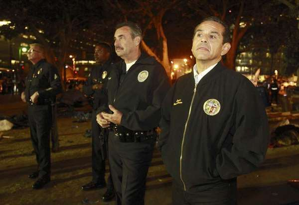 Mayor Antonio Villaraigosa and LAPD chief Charlie Beck survey City Hall park after Occupy L.A. protesters were cleared out by police.