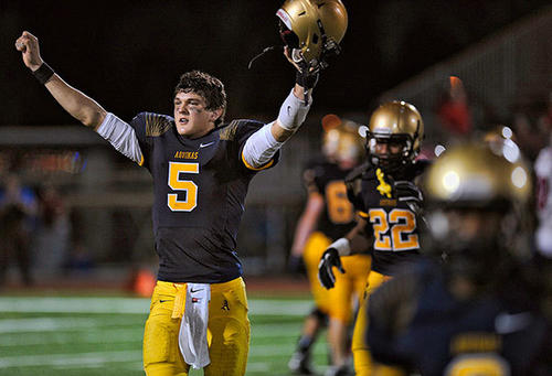 St. Thomas Aquinas quarterback John O'Korn walks off the field in victory after beating Manatee, Friday, December 7, 2012.
