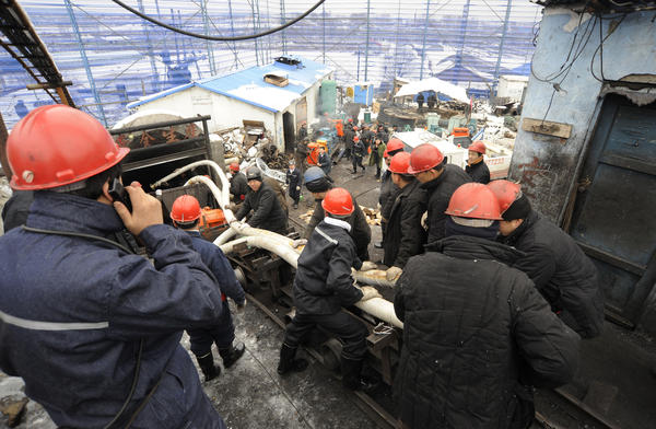 Rescuers pump water out from a flooded pit of a coal mine in Qitaihe, Heilongjiang province.