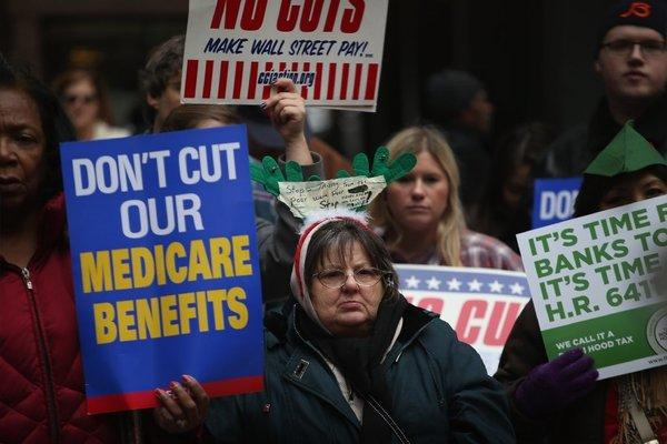 Protestors call for an increase of taxes on the wealthy and voice opposition to cuts in Social Security, Medicare and Medicaid during a demonstration in Chicago on Thursday.