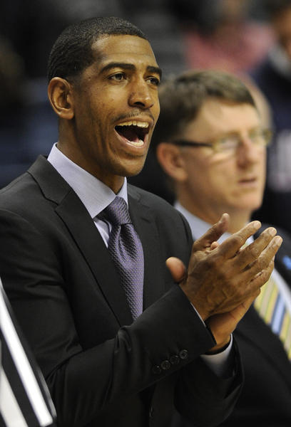 UConn coach Kevin Ollie likes the way things are going Friday against Harvard.