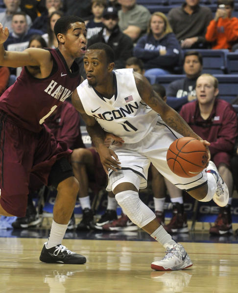 UConn's Ryan Boatright drives against Harvard Friday in Storrs.