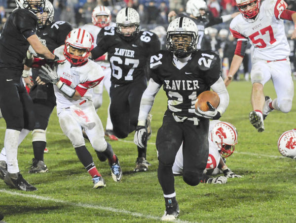 DeAngelo Berry steps into the end zone for one of his three touchdowns in the Class LL football championship game. DeAngleo led Xavier to a 48-14 win over Norwich Free Academy.