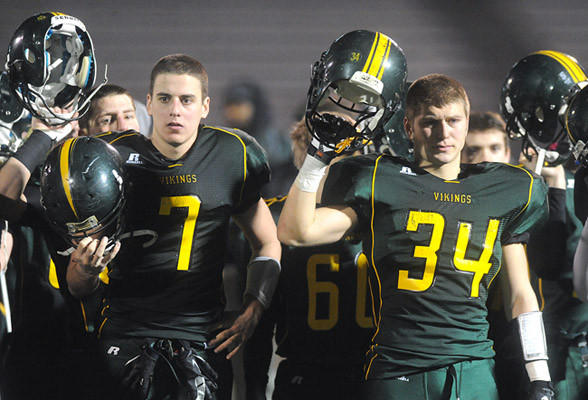 Members of Central Catholic High School football team raise their helmets after their 36 - 6 defeat to Archbishop Wood High School after the semifinal round of the PIAA 3A football tournament Friday night.