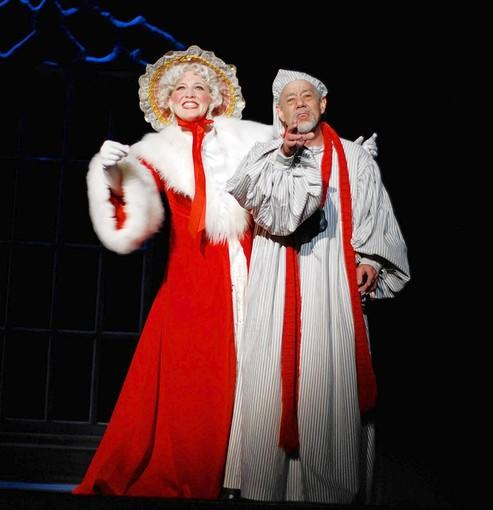 Paul Thomas Kerr is Scrooge and Jessica Bradish is the ghost of Christmas Past in Nebraska Theatre Caravan's musical version of 'A Christmas Carol' Dec. 16 at Easton's State Theatre.