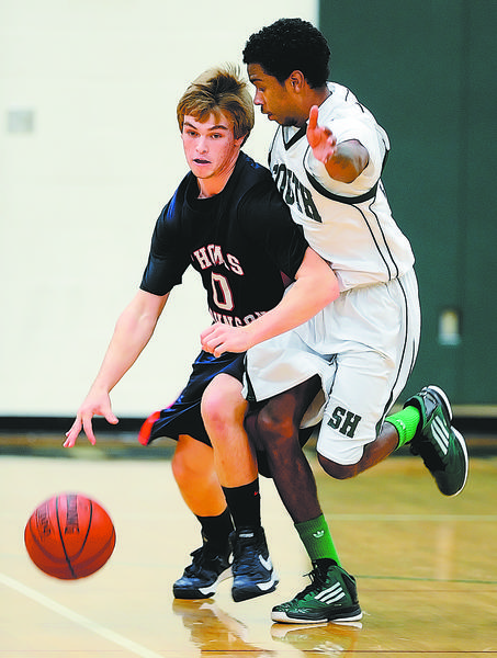 Thomas Johnson's Josh CcLain, left, is defended by South Hagerstown's Xavier Freeman during Friday's boys basketball game.