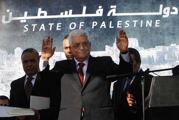 Palestinian Authority President Mahmoud Abbas celebrates in Ramallah after the U.N. vote.