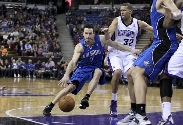 Orlando Magic shooting guard J.J. Redick (7) drives in against Sacramento Kings small forward Francisco Garcia (32) during the first quarter at Sleep Train Arena.