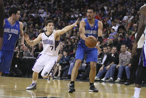 Orlando Magic power forward Gustavo Ayon (19) looks to pass the ball to shooting guard J.J. Redick (7, left) against Sacramento Kings point guard Jimmer Fredette (7) during the second quarter at Sleep Train Arena.