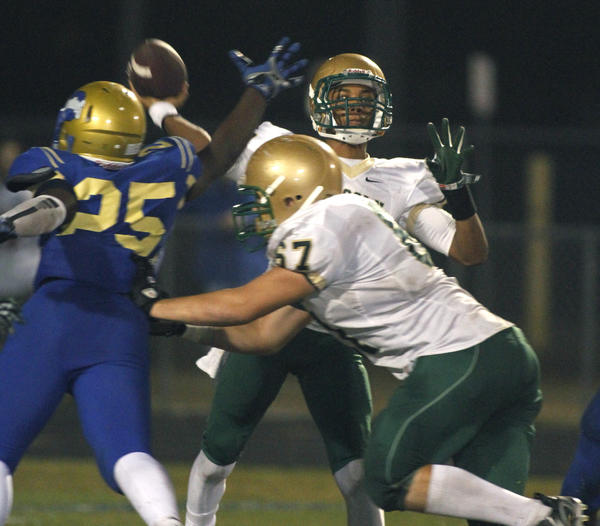 Lincoln quarterback Cameron Joseph throws a pass during a high school football game on Friday,  December 7, 2012 in Kissimmee, Fla. Lincoln defeated Osceola 24-17.
