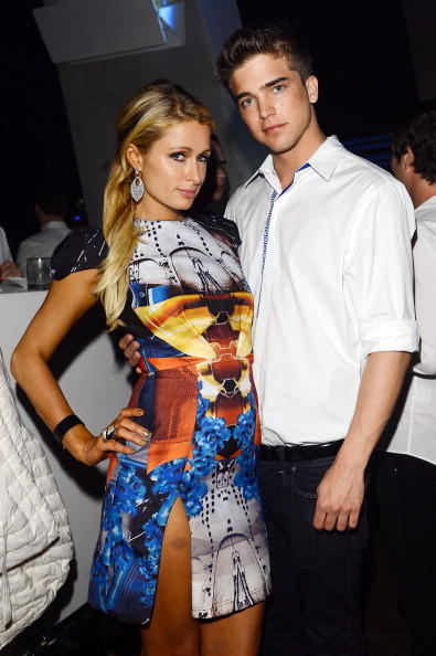 Paris Hilton and River Viiperi attend a private dinner celebrating Remo Ruffini and Moncler's 60th Anniversary during Art Basel Miami Beach on December 7, 2012 in Miami Beach, Florida. (Photo by  for Moncler)