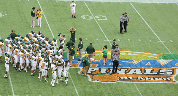University School warms up at the midfield logo before the start of the FHSAA Class 3A championship game. The Suns face Madison County at the Florida Citrus Bowl in Orlando.