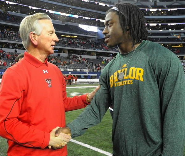 Texas Tech head coach Tommy Tuberville, left, and former Baylor quarterback Robert Griffin III after the Bears won in overtime, 52-45, at Cowboys Stadium in Arlington, Texas, on Saturday, November 24, 2012. (Max Faulkner/Fort Worth Star-Telegram/MCT)