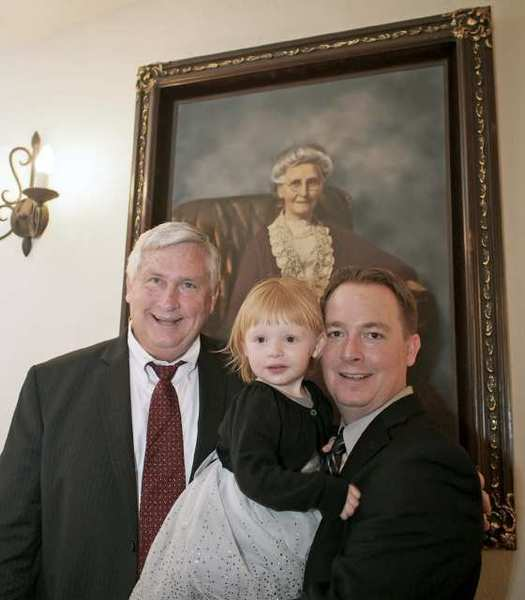 Standing in front of a portrait of Elizabeth Knight, founder of the La Cañada Thursday Club, at the club's 100th anniversary gala, are John Knight, Elizabeth Knight's great-grandson; Cliff Knight, great-great-grandson, and Cliff's daughter, Kimberly.