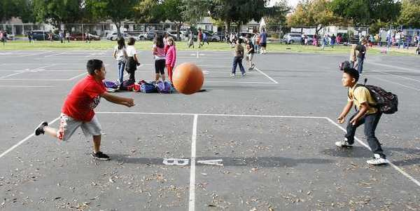 Kids play two square and four square at McKinley Elementary School in Burbank during the After School Daze city run after-school program. The $60,000 program could be cut or restructured next fiscal year.