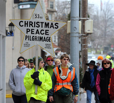 Dmitri Schwartz 13, of Bath (front) leads the walkers at the start of the 53rd Annual Nazareth to Bethlehem Christmas Peace Pilgrimage in Nazareth Saturday afternoon.
