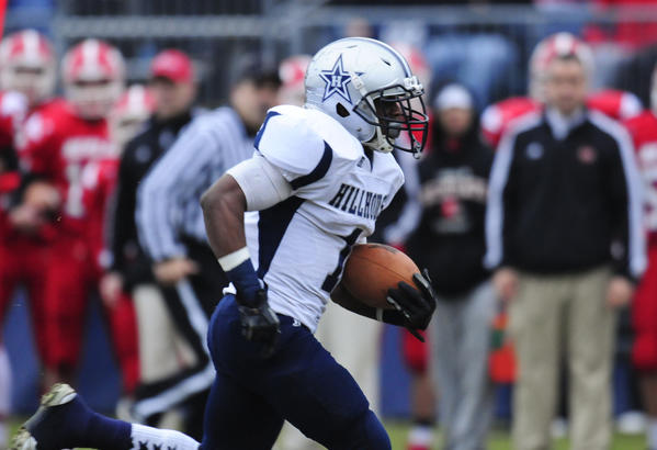 Harold Cooper of Hillhouse is off and running on a 62-yard touchdown reception in the first half against Berlin in the CIAC Class M football championship at Rentschler Field in East Hartford.