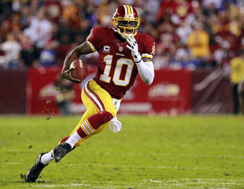 Defending strong-armed, speedy Redskins rookie quarterback Robert Griffin III represents a supreme challenge for the Ravens' injury-riddled defense.<br> <br> How do you slow down a gifted, elusive quarterback who's accurate, smart, athletic, tough and riding a wave of momentum?<br> <br> Ravens defensive coordinator Dean Pees seems to have a sound plan.<br> <br> The Ravens want to keep Griffin contained in the pocket, not be overly aggressive at reacting to ball fakes and the constant backfield shifts of the read-option oriented pistol offense and play their coverage techniques.<br> <br> What typically happens is defenses overreact to Griffin, get flustered and he buys so much time that the secondary breaks down and one of his fast receivers is wide