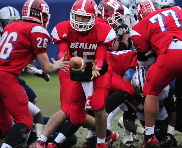 Berlin quarterback Mitch Williams pitches the ball to Scott McLeod in the CIAC Class M football championship game against Hillhouse at Rentschler Field in East Hartford.
