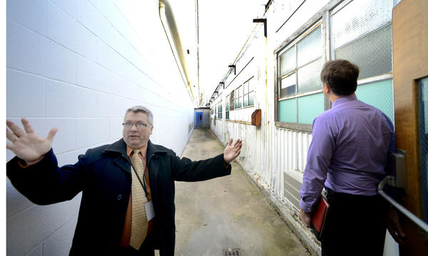 WCPS Dir. of Maintenance & Operation, Mark Mills, stands where two buildings are positioned next to each other creating a skinny long makeshift corridor at the WCPS Central Office.