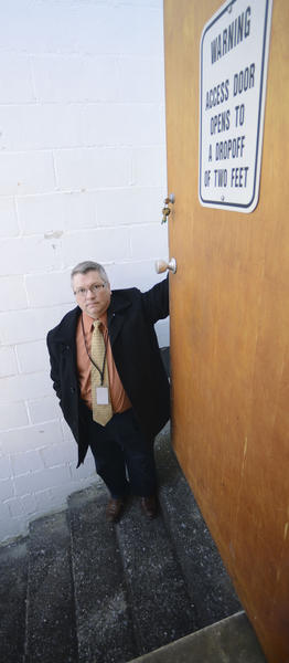 WCPS Dir. of Maintenance & Operation, Mark Mills, stands by a door that opens to a dropoff of two feet at the WCPS Central Office.