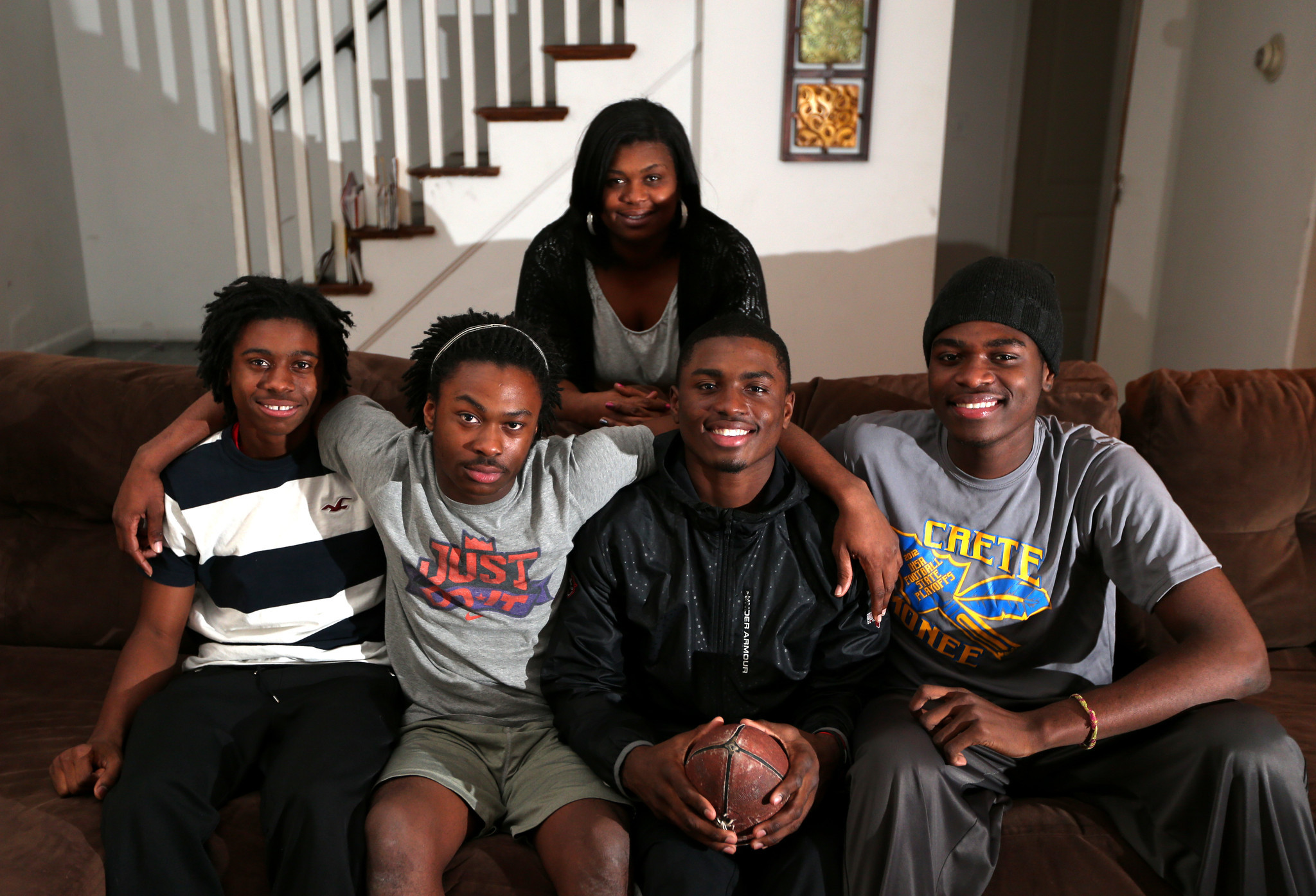 Portrait of 2012 Chicago Tribune football player of the year Laquon Treadwell (second from right), with his family at their home in University Park on Thursday, Dec. 6, 2012. Left to right are brothers Juawan, 15, Darrell, 16, Laquon, and Laron (cq), 18. In back is his mother, Tami.