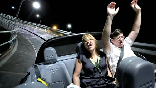 Angie and Patrick Manteiga, of Tampa, enjoy the fastest part of the ride at the grand opening of the new Test Track at Walt Disney World's Epcot park, December 6, 2012.