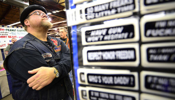Moby Breed of Philadelphia looks at decals for sale at the Motorcycle Extravaganza at the Agri-Plex at the Allentown Fairgrounds Saturday. The show continues 10 a.m. to 4 p.m. Sunday. Tickets are $10; children 5 and under are free.