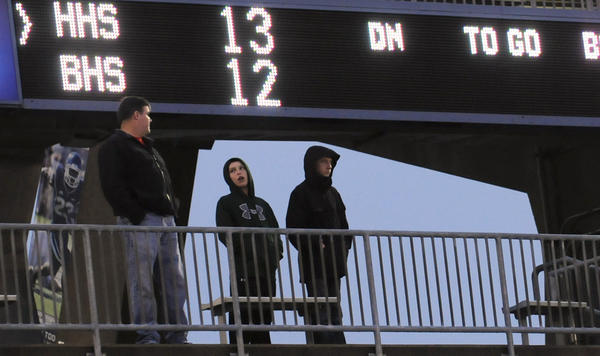 In the upper deck of the stadium, fans watch the CIAC Class M football championship game between Hillhouse and Berlin at Rentschler Field in East Hartford on Saturday afternoon.