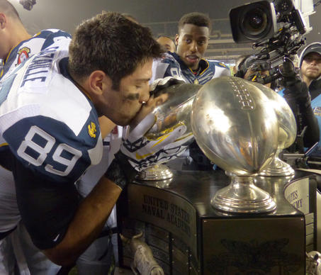 Navy wide receiver Jonathan Gazaille kisses the Commander-in-Chief's Trophy after the Midshipmen defeated Army, 17-13, in the 113th meeting between the academies in football at Lincoln Financial Field in Philadelphia.