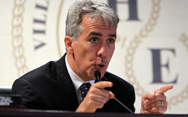 U.S. Congressman Joe Walsh, of the 8th District, reacts to small business owners and managers as they discuss the impact of high fuel prices on small businesses at the Hoffman Estates Village Hall in Hoffman Estates last month.