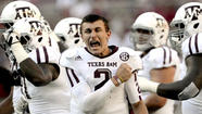 Texas A&M's Johnny Manziel first freshman to win Heisman Trophy