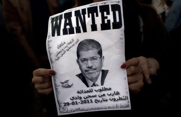 An Egyptian protester carries a poster with a picture of President Mohamed Morsi during an anti-Morsi protest in Cairo on Friday.