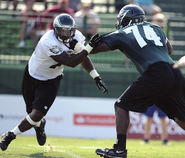 Eagles Vinny Curry is held off by D. J. Jones (right) during practice Tuesday afternoon. Philadelphia Eagles rookies and selected vets practice at Lehigh University training camp Tuesday July 24, 2012.