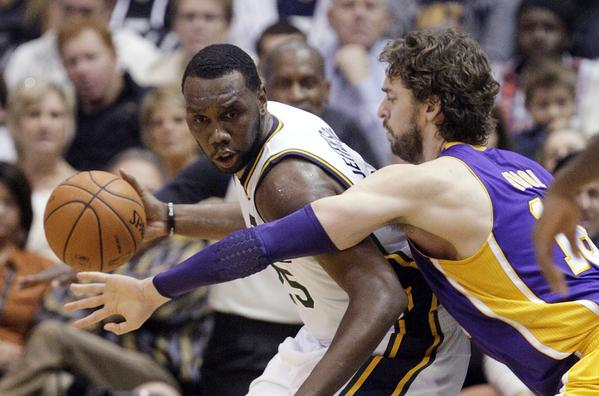 Pau Gasol defends Utah center Al Jefferson during the Lakers' 95-85 loss to the Jazz last month.