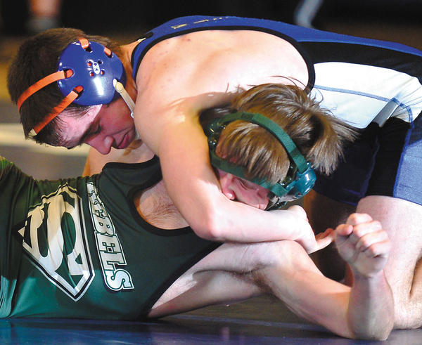 Boonsboro's Dalton Hawkins, top, locks up South Hagerstown's Luke Heinrich in their bout at 132 pounds Saturday in a tri-meet at Williamsport. Hawkins pinned Heinrich in the second period.